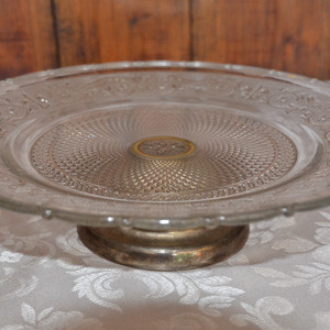 Vintage-looking-glass-cake-stand.-Silver-foot
